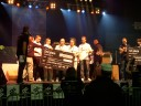 SK.swe receiving their check on the stage
