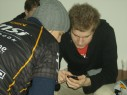 fnatic f0rest and dsn look at something on a mobile phone
